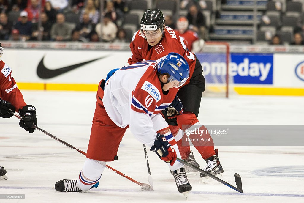 Timo Meier #28 of Switzerland battles for the puck against David Kampf #10 of Czech Republic during the 2015 IIHF World Junior Championship on December 27, 2014 at the Air Canada Centre in Toronto, Ontario, Canada.