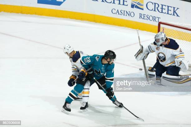 Timo Meier of the San Jose Sharks along with Josh Gorges and Robin Lehner of the Buffalo Sabres watch the puck go wide of the goal at SAP Center at...