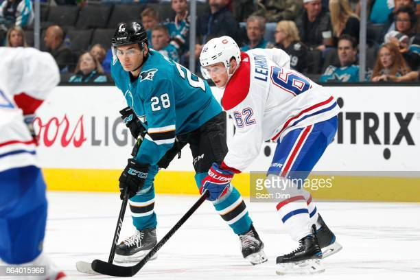 Timo Meier of the San Jose Sharks and Artturi Lehkonen of the Montreal Canadiens get ready at SAP Center on October 17 2017 in San Jose California