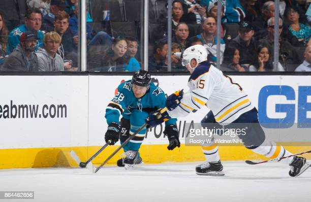 Timo Meier of the San Jose Sharks and Jack Eichel of the Buffalo Sabres battle for the puck at SAP Center on October 12 2017 in San Jose California