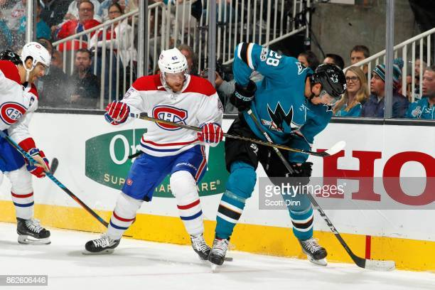 Timo Meier of the San Jose Sharks and Joe Morrow of the Montreal Canadiens battle for the puck along the boards at SAP Center on October 17 2017 in...