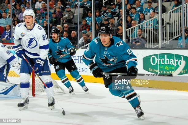 Timo Meier of the San Jose Sharks and Mikhail Sergachev of the Tampa Bay Lightning watch the puck at SAP Center on November 8 2017 in San Jose...