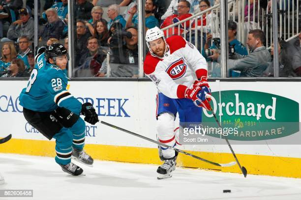 Timo Meier of the San Jose Sharks and Shea Weber of the Montreal Canadiens race for the puck at SAP Center on October 17 2017 in San Jose California