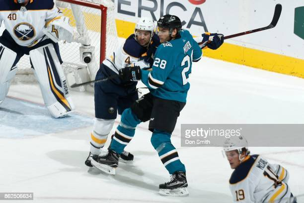 Timo Meier of the San Jose Sharks is defended by Josh Gorges of the Buffalo Sabres at SAP Center at San Jose on October 12 2017 in San Jose California