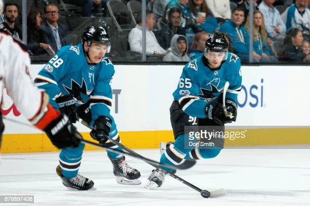 Timo Meier of the San Jose Sharks moves the puck as Daniel O'Regan of the San Jose Sharks skates during a NHL game against the Anaheim Ducks at SAP...