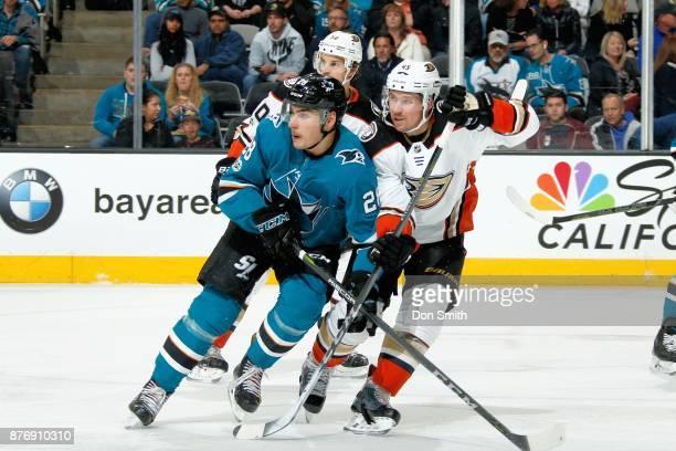 Timo Meier of the San Jose Sharks skates against Antonie Vermette of the Anaheim Ducks at SAP Center on November 20 2017 in San Jose California