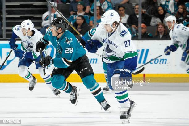 Timo Meier of the San Jose Sharks skates against Ben Hutton of the Vancouver Canucks at SAP Center at San Jose on April 4 2017 in San Jose California