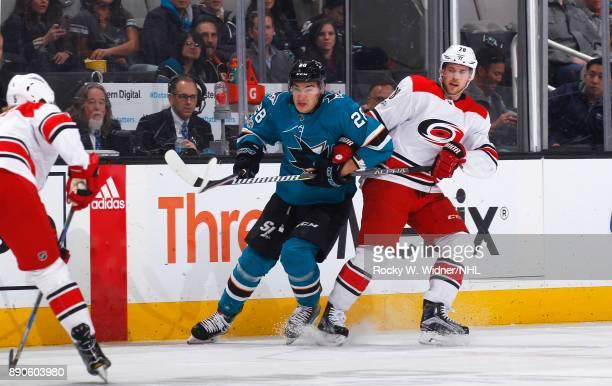 Timo Meier of the San Jose Sharks skates against Elias Lindholm of the Carolina Hurricanes at SAP Center on December 7 2017 in San Jose California