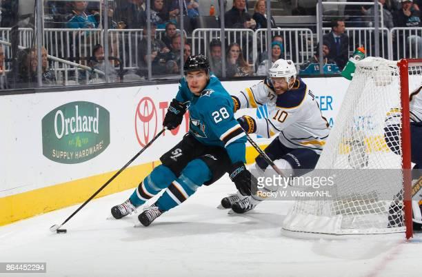 Timo Meier of the San Jose Sharks skates against Jacob Josefson of the Buffalo Sabres at SAP Center on October 12 2017 in San Jose California