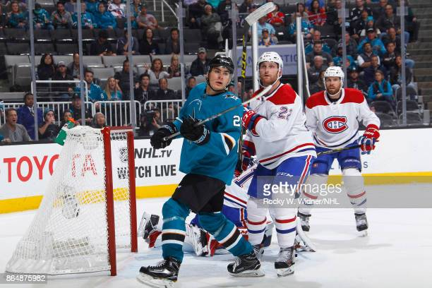 Timo Meier of the San Jose Sharks skates against Karl Allner of the Montreal Canadiens at SAP Center on October 17 2017 in San Jose California