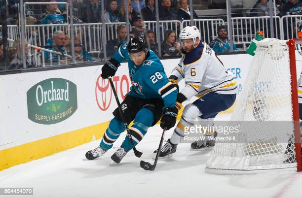 Timo Meier of the San Jose Sharks skates against Marco Scandella of the Buffalo Sabres at SAP Center on October 12 2017 in San Jose California