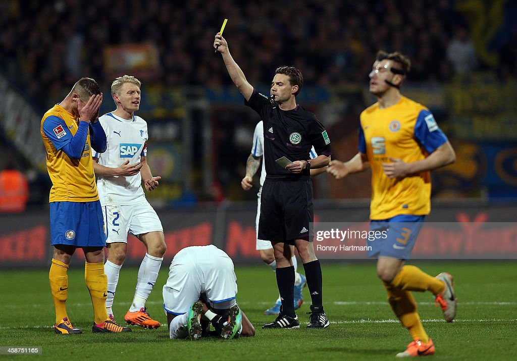 Timo Perthel of Braunschweig receives a second yellow card from referee Guido Winkmann during the Bundesliga match between Eintracht Braunschweig and...
