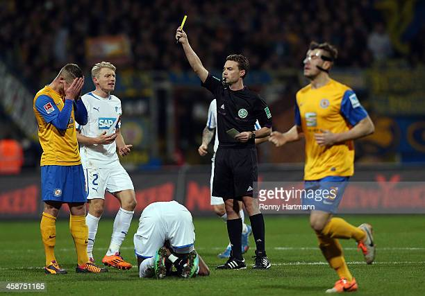 Timo Perthel of Braunschweig receives a second yellow card from referee Guido Winkmann during the Bundesliga match between Eintracht Braunschweig and...