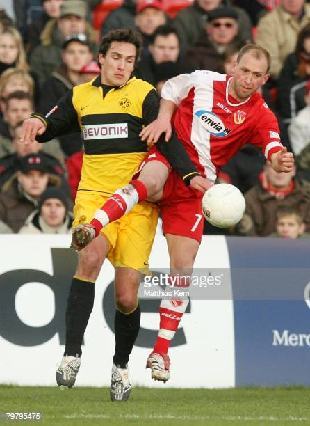 Timo Rost of Cottbus battles for the ball with Mats Julian Hummels of Dortmund during the Bundesliga match between FC Energie Cottbus and Borussia...