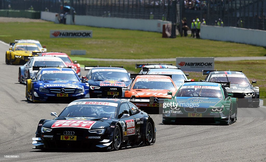 Timo Scheider of Germany and Audi Sport Team Abt leads the pack into the first corner during the first round of the DTM 2013 German Touring Car Championship at Hockenheimring on May 5, 2013 in Hockenheim, Germany.