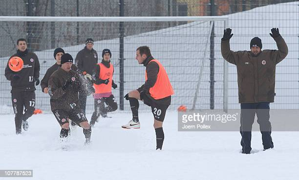 Timo Schultz and Matthias Lehmann of St Pauli battle for the ball during a training session on December 27 2010 in Hamburg Germany