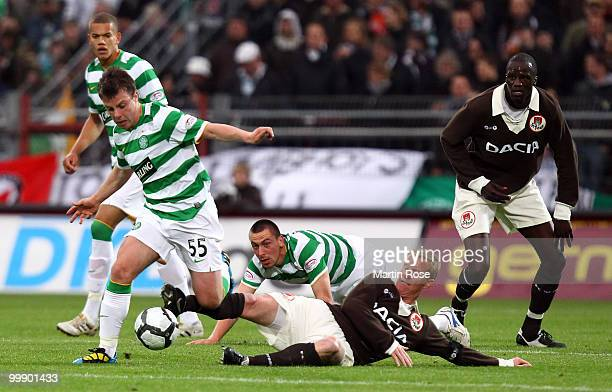 Timo Schultz of St Pauli is challenged by Paul McGowan of Celtic during the friendly match between FC St Pauli and Celtic at the Millerntor Stadium...