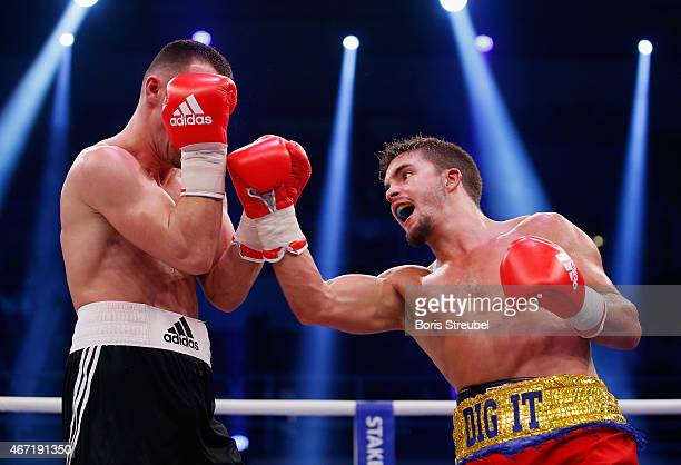 Timo Schwarzkopf of Germany and Anthony Yigit of Sweden exchanges punches during their light welterweight fight at Stadthalle Rostock on March 21...
