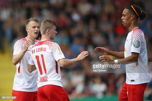 Timo Werner celebrates his team's third goal with team mates Lukas Klostermann and Yussuf Poulsen during the DFB Cup first round match between...