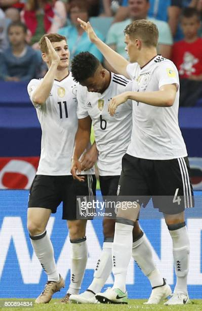 Timo Werner celebrates with Benjamin Henrichs and Matthias Ginter after scoring Germany's third goal in the second half of a Group B match against...
