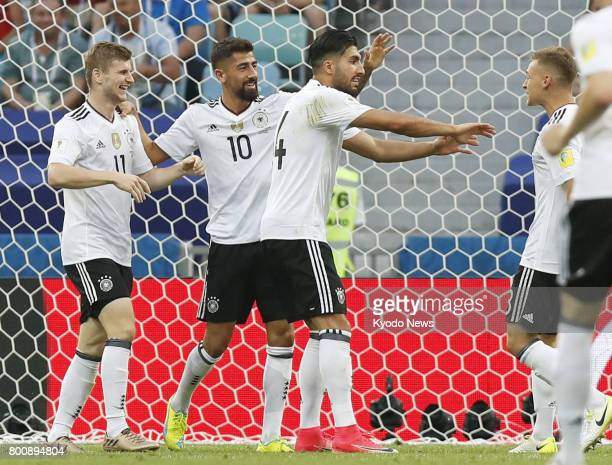 Timo Werner celebrates with teammates after scoring Germany's second goal in the second half of a Group B match against Cameroon in Sochi Russia at...