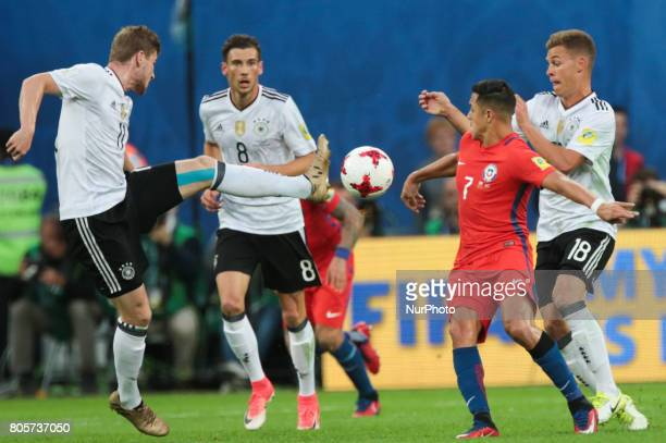 Timo Werner Leon Goretzka of the Germany national football team and Alexis Sanchez of the Chile national football team vie for the ball during the...