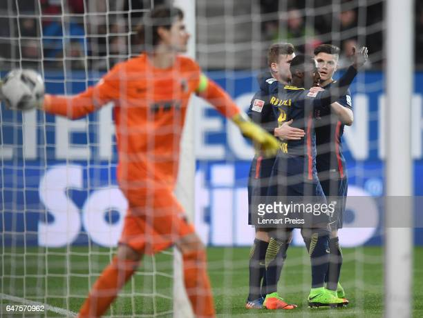 Timo Werner Naby Deco Keita and Marcel Sabitzer of RB Leipzig celebrate their side's first goal during the Bundesliga match between FC Augsburg and...