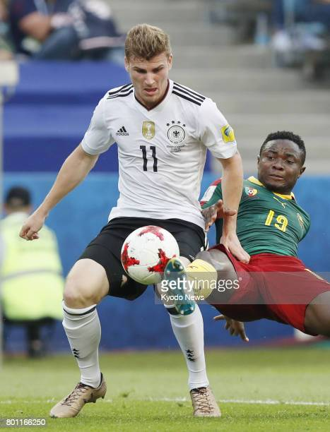 Timo Werner of Germany and Collins Fai of Cameroon vie for the ball during the first half of a Group B match at the Confederations Cup in Sochi...