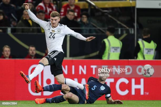 Timo Werner of Germany and Gary Cahill of England battle for the ball during the international friendly match between Germany and England at Signal...