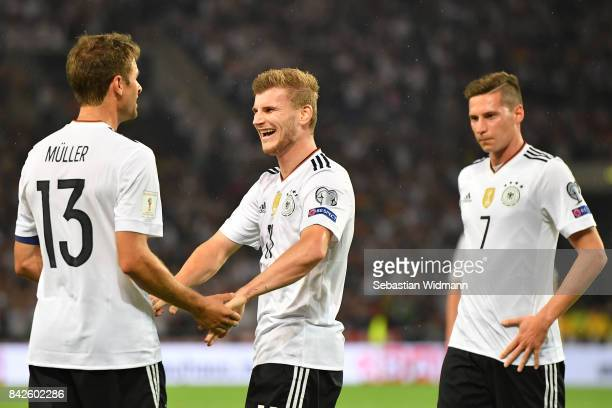 Timo Werner of Germany celeberates with Julian Draxler of Germany and Thomas Mueller of Germany after he scored to make it 40 during the FIFA 2018...