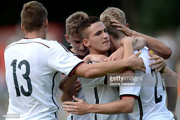 Timo Werner of Germany celebrates after scoring his team's first goal with team mate Donis Avdijaj during the international friendly match between...
