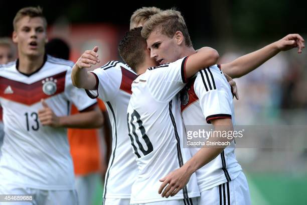 Timo Werner of Germany celebrates after scoring his team's first goal with team mates Donis Avdijaj and Max Christiansen during the international...