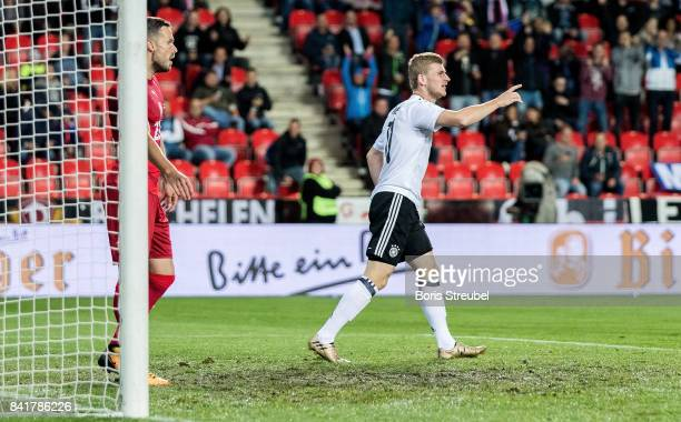 Timo Werner of Germany celebrates after scoring his team's first goal during the FIFA 2018 World Cup Qualifier between Czech Republic and Germany at...
