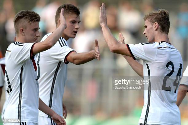 Timo Werner of Germany celebrates after scoring his team's second goal with team mates Max Christiansen and Sinan Kurt during the international...