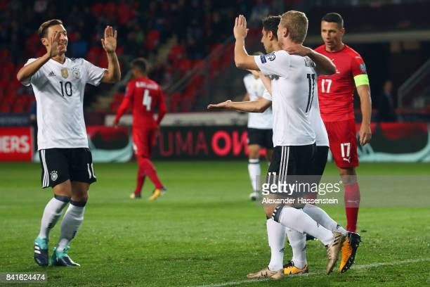 Timo Werner of Germany celebrates his team's first goal with team mates Lars Stindl and Mesut Oezil during the FIFA World Cup Russia 2018 Group C...