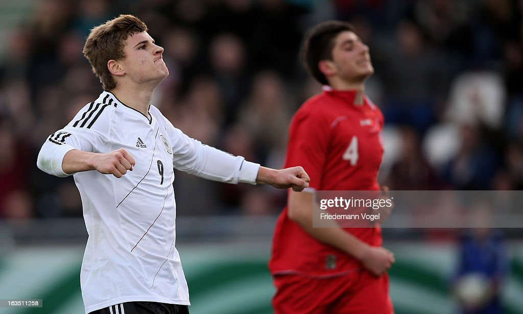 Timo Werner of Germany celebrates scoring the first goal during the U17 International Friendly match between Germany and Georgia at Toennies-Arena on March 6, 2013 in Rheda-Wiedenbruck, Germany.