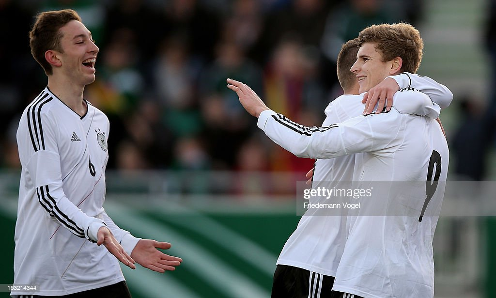 Timo Werner (R) of Germany celebrates with Rico Preissinger (L) and team-mate after scoring the first goal with during the U17 International Friendly match between Germany and Georgia at Toennies-Arena on March 6, 2013 in Rheda-Wiedenbruck, Germany.