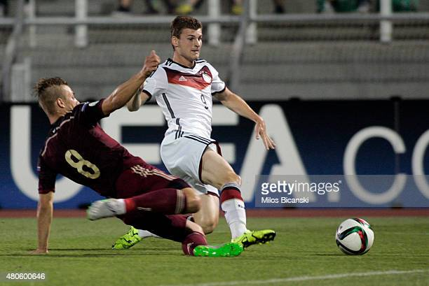 Timo Werner of Germany competes with Dmitri Barinov of Russia during the UEFA European Under19 Championship group stage match between U19 Russia and...