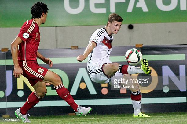 Timo Werner of Germany competes with Jesus Vallejo of Spain during the UEFA U19 Championship 2015 final tournament match between Spain and Germany at...