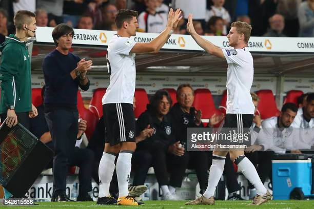 Timo Werner of Germany is being substituted for Mario Gomez of Germany as Joachim Loew national coach of Germany claps during the FIFA 2018 World Cup...
