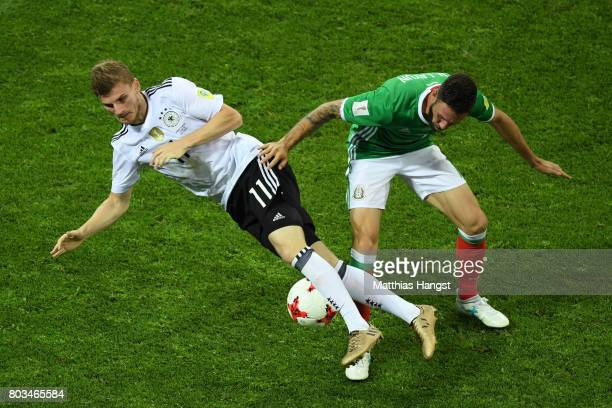 Timo Werner of Germany is challenged by Miguel Layun of Mexico during the FIFA Confederations Cup Russia 2017 SemiFinal between Germany and Mexico at...