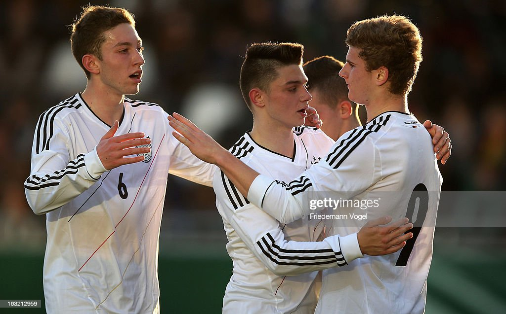 Timo Werner (R) of Germany is congratulated by team-mates after scoring the second goal during the U17 International Friendly match between Germany and Georgia at Toennies-Arena on March 6, 2013 in Rheda-Wiedenbruck, Germany.