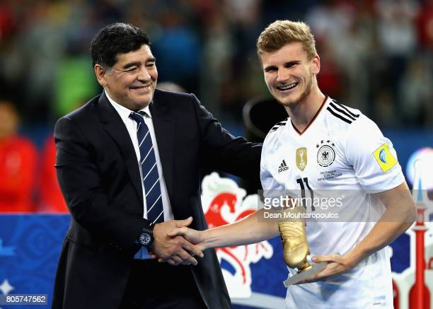 Timo Werner of Germany is presented the golden boots award by Diego Maradona after the FIFA Confederations Cup Russia 2017 Final between Chile and...