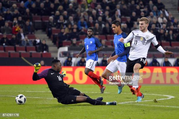 Timo Werner of Germany misses a goal in front of France goalie Steve Mandanda during the international friendly match between Germany and France at...