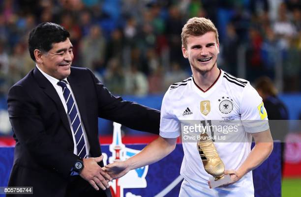 Timo Werner of Germany receives the golden boot from Diego Maradona following the FIFA Confederations Cup Russia 2017 Final match between Chile and...