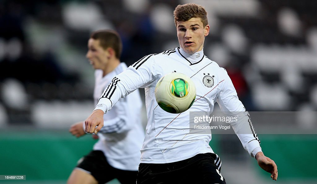 Timo Werner of Germany runs with the ball during the UEFA Under17 Elite Round match between Germany and Bulgaria at Toennies-Arena on March 26, 2013 in Rheda-Wiedenbruck, Germany.