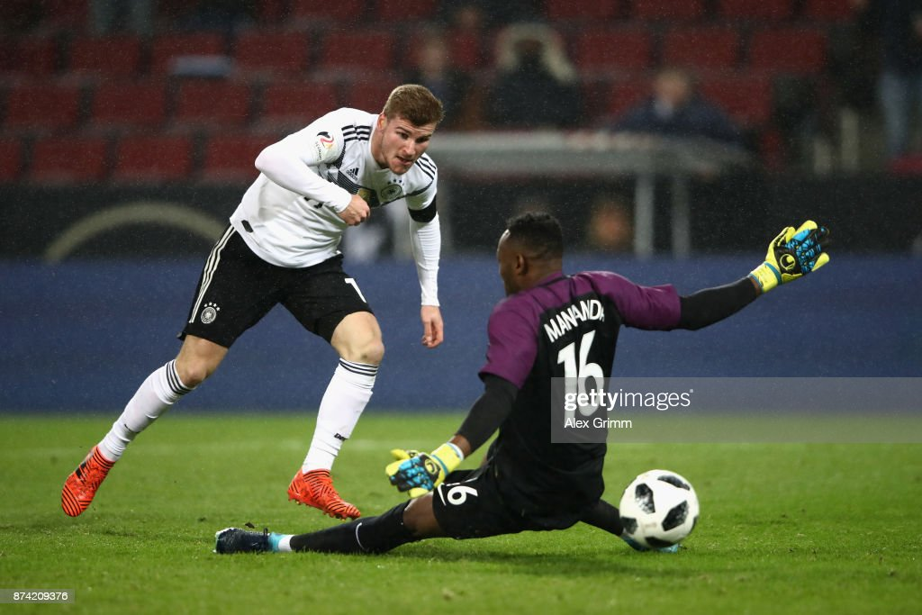 Timo Werner of Germany scores his sides first goal past Steve Mandanda of France during the international friendly match between Germany and France at RheinEnergieStadion on November 14, 2017 in Cologne, Germany.