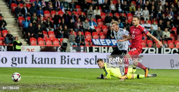 Timo Werner of Germany scores his team's first goal against goalkeeper Tomas Vaclik of Czech Republic during the FIFA 2018 World Cup Qualifier...