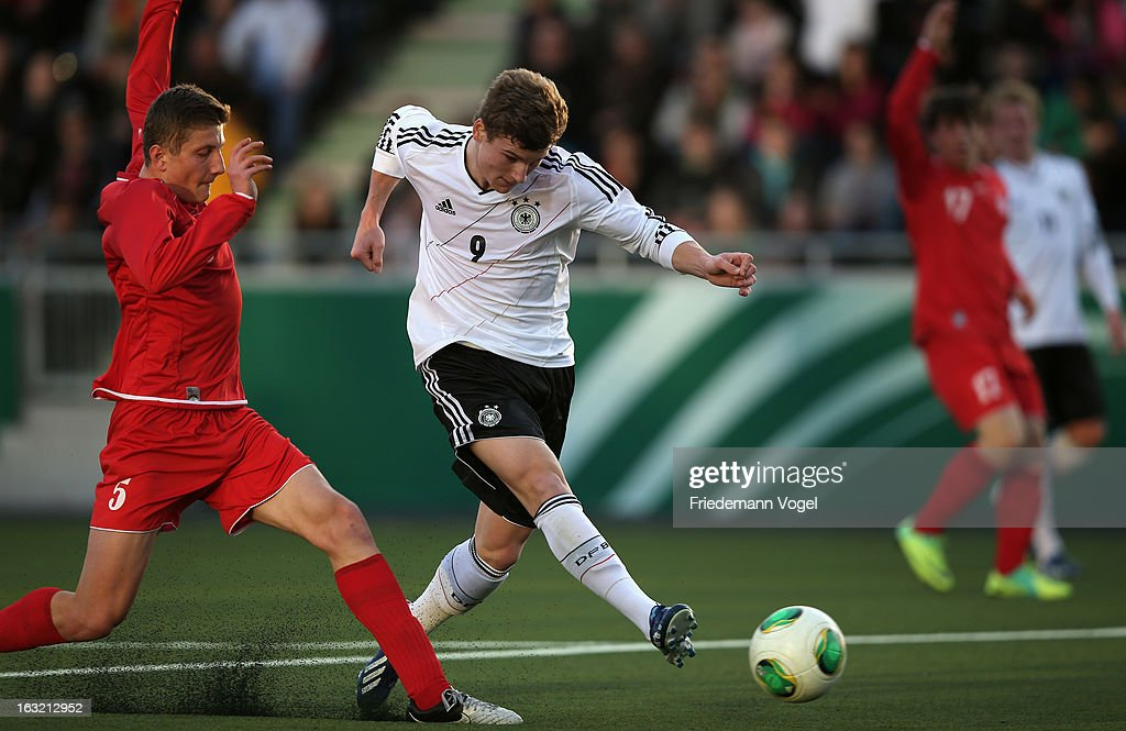 Timo Werner of Germany (C) scores the second goal during the U17 International Friendly match between Germany and Georgia at Toennies-Arena on March 6, 2013 in Rheda-Wiedenbruck, Germany.