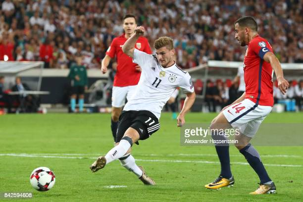 Timo Werner of Germany scores to make it 30 for Germany while Omar Elabdellaoui of Norway looks on during the FIFA 2018 World Cup Qualifier between...